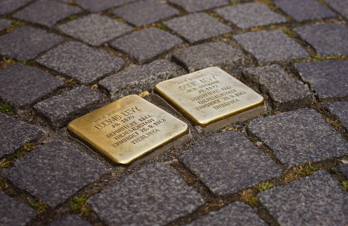 Dozens of stolpersteine installed on Berlin streets in memory of Jews murdered in Holocaust