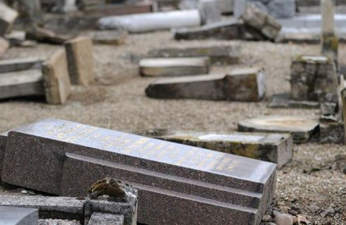 Hundreds of tombs vandalized in Jewish graveyard in France