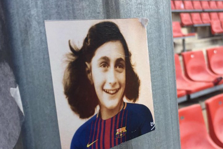 Stickers bearing image of Anne Frank wearing Barcelona football shirts distributed by fans of rival Espanyol team